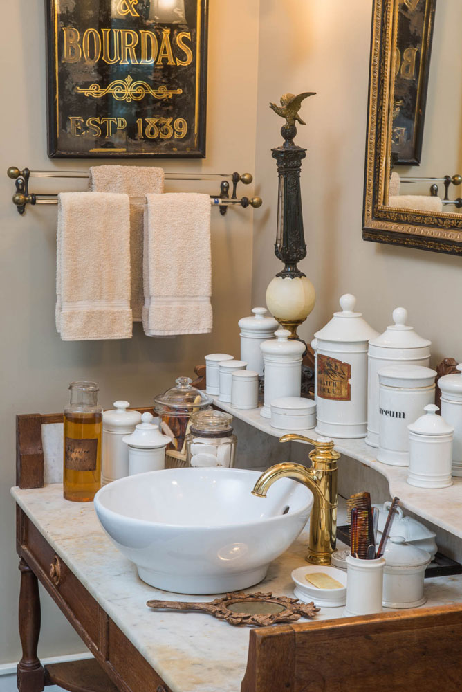 18th century apothecary jar collection in a bathroom